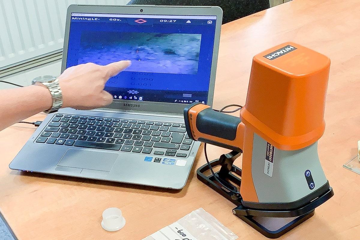 Laptop and a Hitachi camera on a desk